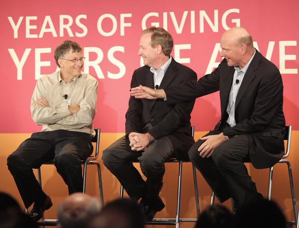 "Microsoft co-founder Bill Gates (left), executive vice president Brad Smith (center) and CEO Steve Ballmer speak during a ""30 Years of Giving"" celebration at Microsoft's Redmond headquarters."