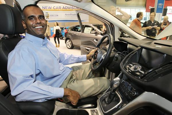 Pranish Kumar, Microsoft group project manager for the automotive team, sits in a newly unveiled Ford C-MAX Energi plug-in hybrid car on display at the Seattle Auto Show on Wednesday. Kumar's team developed some of the digital interface technology.