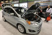 A newly unveiled Ford C-MAX Energi plug-in hybrid car on display at the Seattle Auto Show on Wednesday.