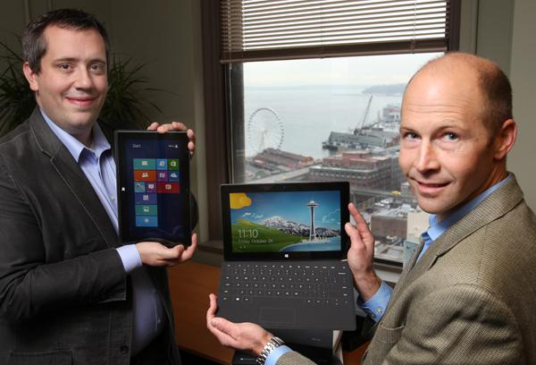 Slalom Consulting's Daniel Maycock, left, and Justin Jarrett show the new Surface tablet that launched with Windows RT in their offices in Seattle. Jarrett lined up at the Microsoft Store in University Village in Seattle at 7:30am on Friday to be one of the first customers to purchase the the device when they went on sale.