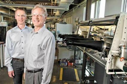 Lars Johansson (left) and Byron McCann, who co-chair Northwest  Energy Angels, visit one of the group's investment targets, EnerG2.  The Seattle company creates materials that improve the performance of  batteries and other energy storage devices — making EnerG2 one of many  local firms to focus on innovation in energy efficiency rather than  trying to create and sell renewable energy in competition with  traditional low-cost energy suppliers.
