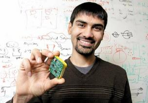 University of Washington Assistant Professor Shwetak Patel, shown in his office at the UW's Paul G. Allen Center for Computer Science & Engineering, holds a device he developed that measures home power use. Patel has launched several companies, at two universities.