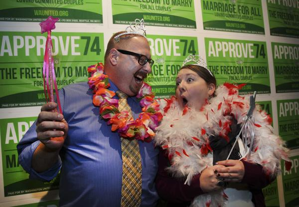 Referendum 74 supporters Jason Lee (left) and Erin Lee of Tacoma have fun while attending the Election Night festivities at the Westin Hotel in Seattle, November 6, 2012.