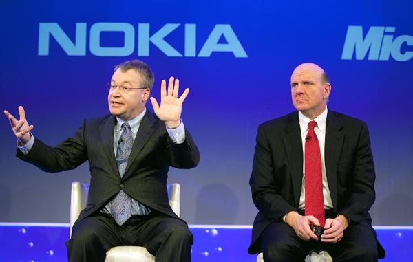 Nokia CEO Stephen Elop, left, with Microsoft CEO Steve Ballmer.