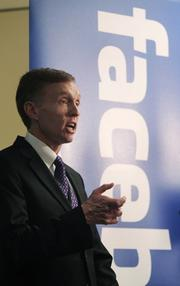 Washington State Attorney General Rob McKenna speaks at a press conference at Facebook's Seattle office