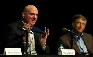 Microsoft CEO Steve Ballmer and Chairman Bill Gates, appearing at the company's annual shareholders meeting, deflected questions about large cash reserves and their resistance to breaking the company apart. (PSBJ photo / Stephen Brashear)