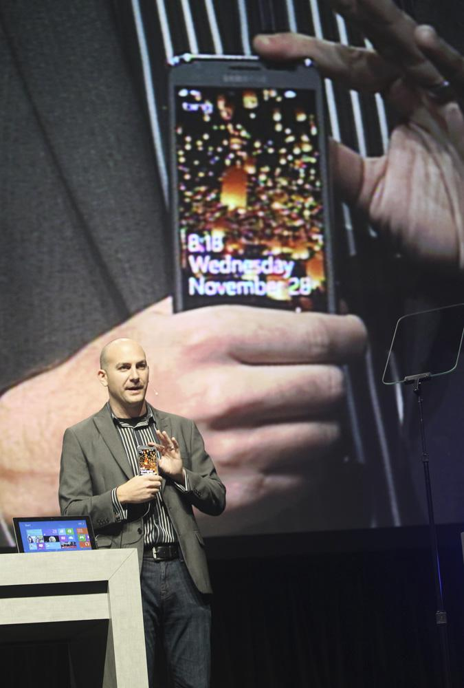 Ryan Asdurian, Microsoft senior product marketing manager, presents a Windows 8 Phone at the annual Microsoft shareholders meeting at Meydenbauer Center in Bellevue on Wednesday.