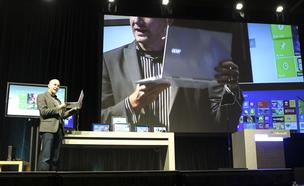Ryan Asdurian, Microsoft Senior Product Marketing Manager, shows an Acer laptop using the Windows 8 operating system during his presentation at the annual Microsoft Shareholders Meeting
