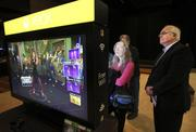 Microsoft shareholders check out the XBox video-game display at the annual Microsoft shareholders meeting in Bellevue on Wednesday.