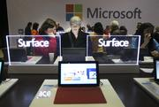 Microsoft shareholder Shirley Shaffer (left) and her guest, Donna Lopardi, both from Oregon, take a look at the Surface laptop with Windows 8 operating system display at the annual Microsoft shareholders meeting Wednesday.