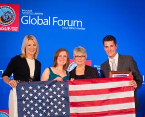 Robin Lowell, second from left, and Sherry Hahn, third from left, accept their second-place Cutting-Edge Use of Technology for Learning award from Microsoft's Laura Ipsen and Anthony Salcito in Prague.