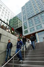Amazon.com employees walk to lunch from their offices in December 2011 at the 310 Terry building of Amazon.com's headquarters campus, which is a mix of office space (upper right) and new restaurants.