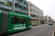 A streetcar whizzes past Amazon.com's Seattle headquarters in South Lake Union.