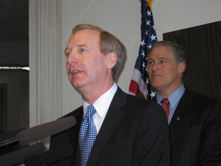 Microsoft General Counsel Brad Smith, left, has been named a co-chair  of the transition team for Washington Gov.-Elect Jay Inslee, right.