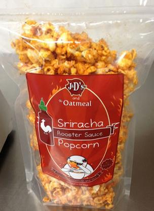 The Oatmeal and J&D's Foods have teamed up to create Sriracha Popcorn.