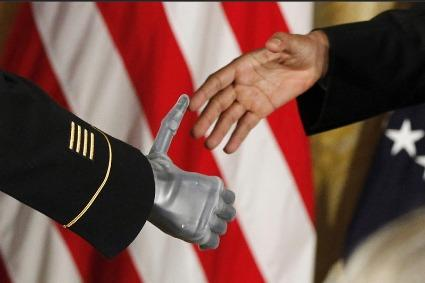 Corbis will be able to make AP breaking news photos like this one showing President Obama shaking hands with Medal of Honor recipient U.S. Army Sgt. Leroy Arthur Petry immediately available to clients. (AP images via Corbis)
