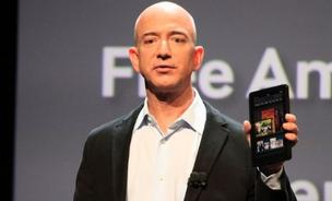 Amazon's Jeff Bezos has seen Kindle Fire sell briskly, but not as much as the rival iPad
