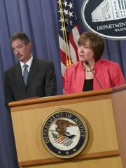 Deputy Attorney General James Cole (left) and Sharis Pozen, Acting Assistant Attorney General of the Antitrust Division, at Wednesday press conference. (DOJ image)