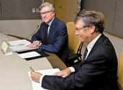 Bill Gates (right), co-chair of the Bill & Melinda Gates Foundation, told foundation CEO Jeff Raikes (left) that he would have to compete for the job. Here the two men sign an agreement on polio eradication with the Japan International Cooperation Agency.