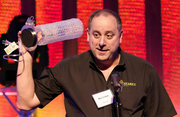 """Roy Leban holds up the Flashie for """"Newcomer of the Year."""" Leban accepted on behalf of the Founder Institute."""