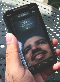 Former Microsoft program manager Alberto Fonseca reflected in the screen of a Sprint Evo Android device using his company's GOTO replacement lock screen. (Marcus Donner/Puget Sound Business Journal)