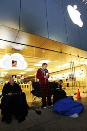Tim Strandrud (left to right), Will Lummus and Alex Brewer camped out over night in front of the University Village Apple Store in Seattle to be the first customers in line to purchase the newly released iPhone 4S Friday. (PSBJ/Anthony Bolante)