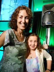 iPrize grand prize winner Elisabeth DeVos and daughter Mari, 9, right after DeVos was handed the $50,000 prize.