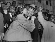 AP's photo archives go back more than 90 years and include stunning historical images from America and abroad. Here we see Martin Luther King Jr. receiving a kiss from his wife, Coretta, after leaving court in 1956 after he was found guilty of conspiracy in connection with the Montgomery, Ala., bus boycott. A judge suspended a $500 fine.