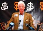 Bill Neukom and his bow tie get a plug during the World Series
