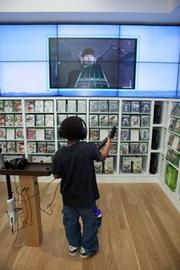 Jamarius Mackey, 7, plays The Beatles: Rock Band on the Xbox 360 at Microsoft's Arizona store on Oct. 22. (Microsoft photo)