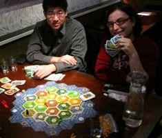 Blogger Ina Fried, right, holds all the right cards at the Settlers of Catan tourney in Seattle.