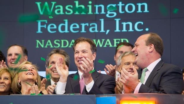 Washington Federal CEO Roy Whiteheadringing the NASDAQ stock market opening bell Friday morning.