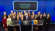 Washington Federal CEO Roy Whitehead and crewgot to participate in this symbol of capitalism to mark Washington Federal's 30th anniversary of becoming a public company in November of 1982.
