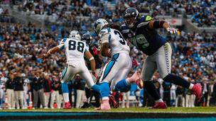 Seattle Seahawks defensive end Red Bryant tackles Carolina Panthers running back DeAngelo Williams during an Oct. 7, 2012, game in Charlotte, N.C.