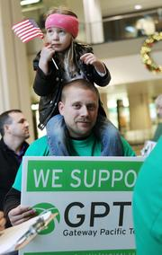 Gateway  Pacific Terminal supporter Joseph Vvrina and his four-year-old daughter  Jolee of Seattle attend a public hearing at the Washington Convention  Center in Seattle.