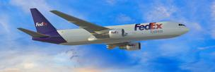 FedEx Corp. says its profit goals are being held up as it waits for delivery of new Boeing 767s.