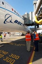 Crews at Sea-Tac check the fit of the jetway to the Dreamliner.
