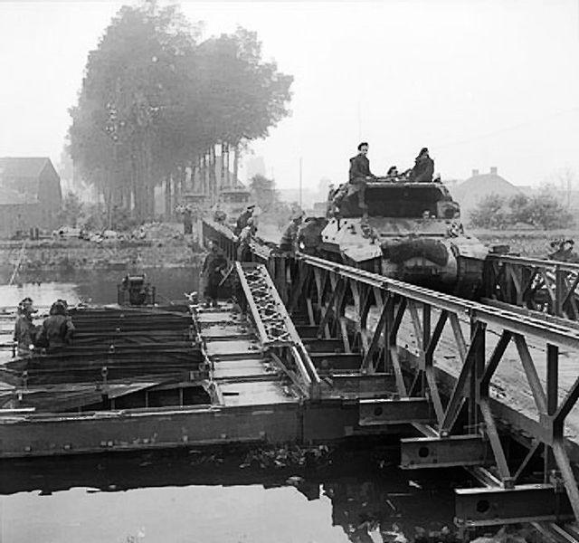 M10 tank destroyers of 77th Anti-Tank Regiment, crossing a Bailey Bridge after the D-Day invasion, in 1944.