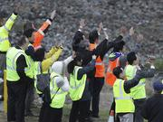 Spectators wave as the first delivered 787 Dreamliner to launch customer All Nippon Airways (ANA) taxis to takes off from Paine Field for Japan.