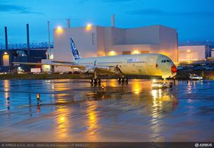 Airbus' first flyable A350 XWB rolls across the wet tarmac outside the Airbus assembly plant in Toulouse, France.