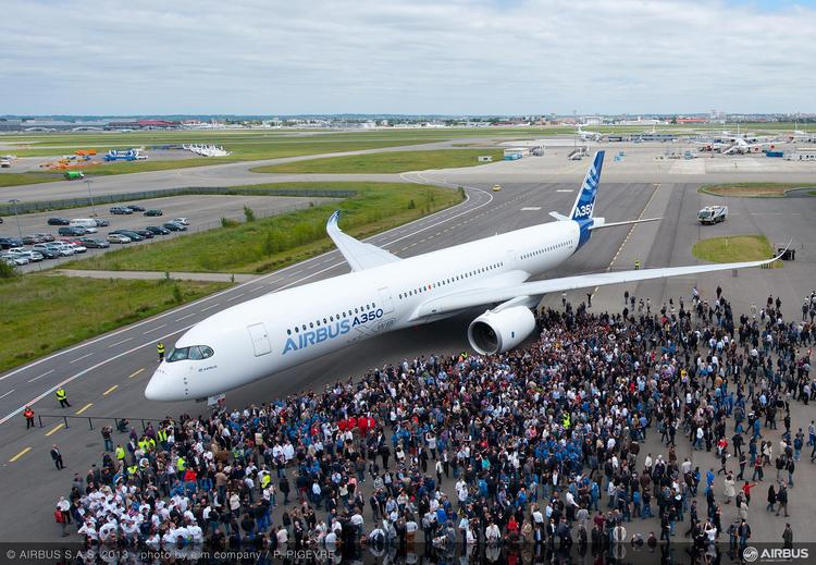 Airbus' A350, here shown shortly after rollout, may fly this week.