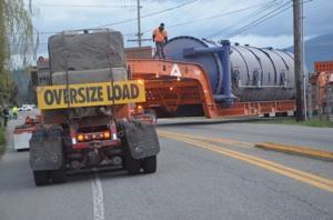 Active Machinery Moving of Lynden, Wash., used a massive trailer to deliver Janicki Industries' new autoclave. Squeezing the 236-foot trailer around corners was a challenge during its journey from California.