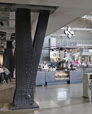 During the renovation of the Armory/ Center House at Seattle Center, the large steel supports were brought out into the open. To the right of the supports is Eltana bagels, which is one of a number of new food options at the Armory.
