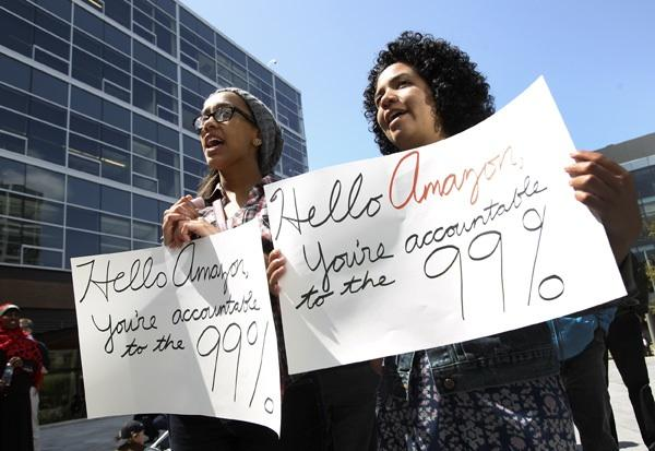Tanesha Tekola (left) and Sera Day demonstrate in front of Amazon.com's corporate headquarters in Seattle on Thursday.
