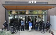 Seattle Police bicycle officers guard the entrance to Amazon.com's corporate headquarters in Seattle during protests Thursday.