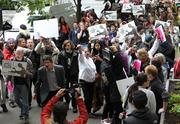 Protesters demonstrate at the Amazon.com shareholders meeting at the Seattle Art Museum on Thursday.