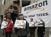Protesters, including Bob Downing (center), demonstrate at the Amazon.com shareholders meeting at the Seattle Art Museum on Thursday.