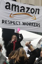 A protestors leads a chant of more than 200 demonstrators at the Amazon.com shareholders meeting at the Seattle Art Museum on Thursday.