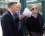 From left, King County Executive Dow Constantine, Seattle Mayor Mike McGinn and Seattle arena investor Chris Hansen chat before a press conference Thursday.