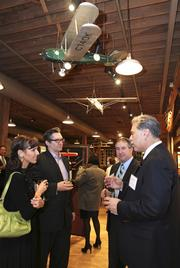 Guests mingle at the Puget Sound Business Journal's Book of Lists Extravaganza: A Salute to the Business Stars on Thursday at the Museum of Flight.